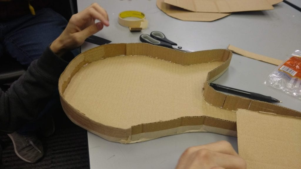 Cardboard electric guitar body construction.