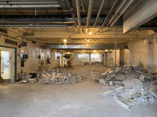 Fabrication studio wall demolition