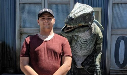 Photo of Michael Walter Gradomski with friend (in dinosaur costume)