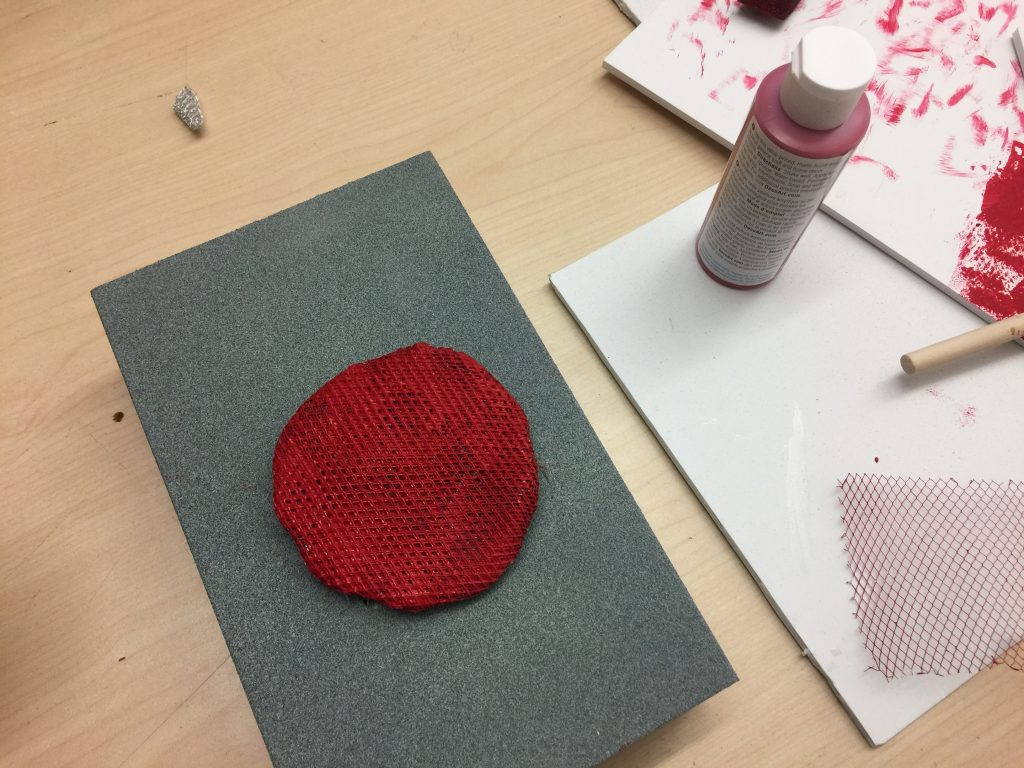 The speaker mesh was hand painted red and sculpted from a sheet of wire mesh, into a circular shape.