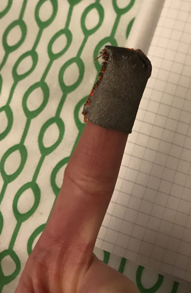 Finger slip made out of conductive material that is used to interact with the potentiometer.