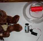 Stuffed Dog, Rubber Tubing, Nylon Cord, 4V Motor, Power Supply (2AAA), Switch, Wiring.