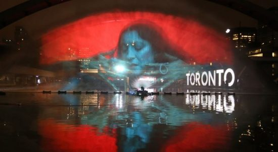 Pneuma, 2016 by artist Floria Sigismondi, part of Nuit Blanche Toronto 2016. The project is projected onto a screen made of water in the reflecting pool at Nathan Phillips Square. - Steve Russell/Toronto Star
