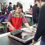 Mary Tremonte demonstrating silkscreening.