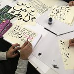 Students at work from the Arabic Calligraphy Workshop