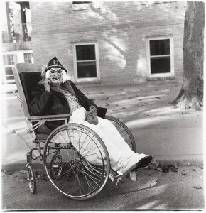 masked-woman-in-a-wheelchair-pa-1970-custom