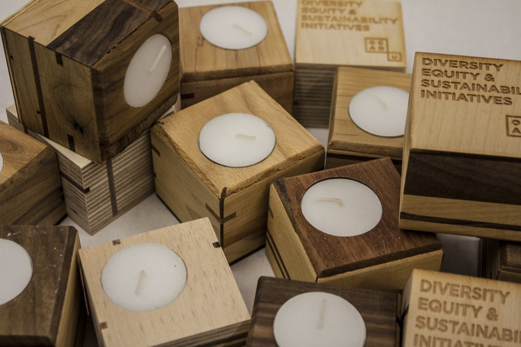 [Image Description: photo of wooden sculptures that also function as tea-light holders]
