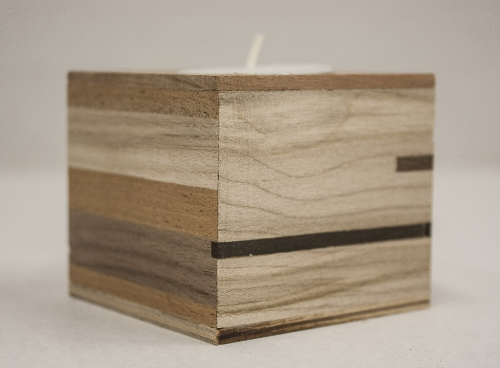 [Image Description: Close-up photo of a wooden cube]