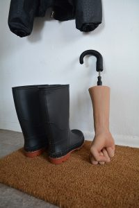 "Protest, Whether Dependent, Gina D'Aloisio.  (Silicone, Nails, Umbrella handle and mechanism, Rubber boots, Doormat, Raincoat and hook) 18"" x 3"" x 3"" 2020"