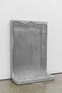 "Dog Towel, Julien Woolley-Fisher. (Cement, Pigment, Dog hair and other debris)30"" x 21"" x 8""2018"