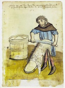 A man removing fur from an animal hide, a step in the parchment making process. Image sourced from botanicalartandartists.com