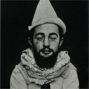 A portrait of the artist revealing his satirical side by dressing as a clown.