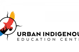 Urban Indigenous Education Centre logo. White background with black text. Image is of a soaring mulitcolored eagle within a medicine wheel outline.