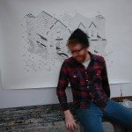 Pretty boy Mike badour sitting in front of his large scale drawing