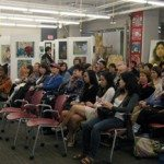 People socializing on opening night of toronto school board art show