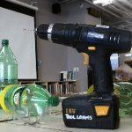 photo of tools: power drill, box cutter, 2L pop bottles
